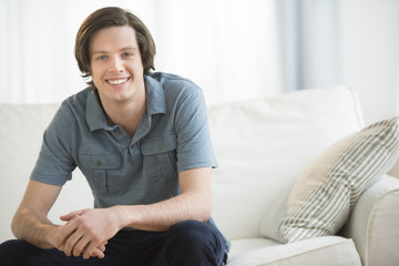 Confident Man Sitting On Sofa