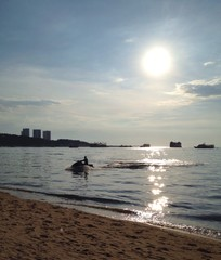 play jet ski on beach with shiny sun light