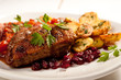 fillet of duck with roasted potatoes, vegetables and cranberry