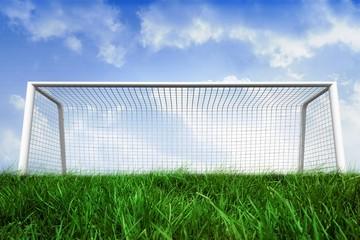 Goalpost on grass under blue sky