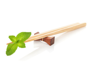 Sushi chopsticks with mint leaves