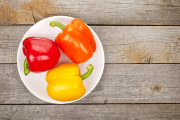 Colorful bell peppers on plate