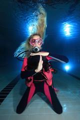 Female scuba diver show underwater signal