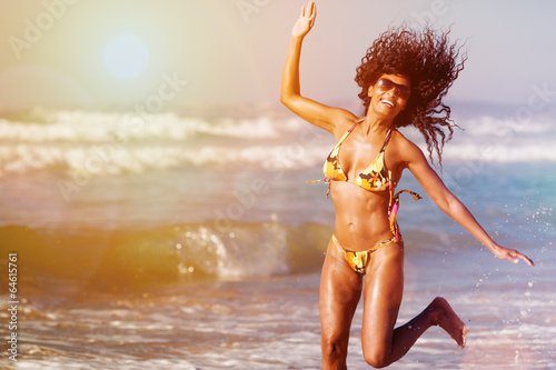 Woman on beach in summer vacation