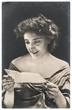 antique portrait of young woman reading letter