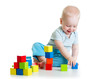 kid boy playing  wooden block toys