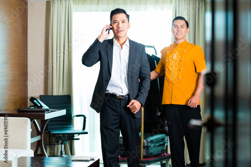 Asian Guest checking in hotel room
