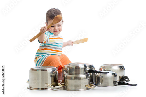 baby boy using wooden spoons to bang pans drumset - 64615950