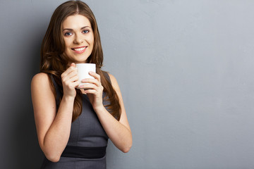 Portrait of woman holding coffee cup.