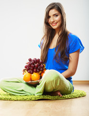 Diet food concept. Woman sitting on a floor