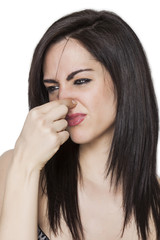 Girl smelling a bad odor profile