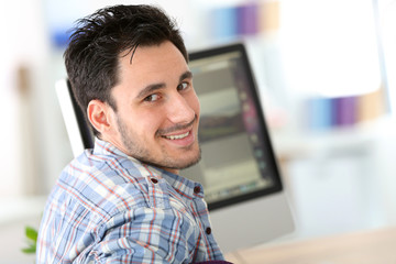 Student in web-design working in office
