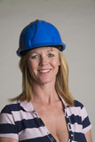 Portrait of a female tradesperson wearing a hardhat poster