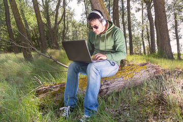 man in the field with computer