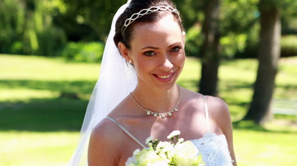 Smiling bride walking towards the camera