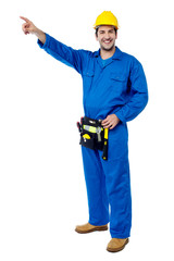 Happy male worker pointing at something