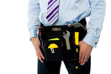 Closeup image of handyman tool belt