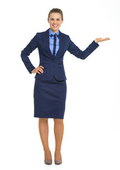 Full length portrait of business woman presenting something