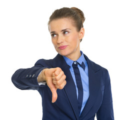 Displeased business woman showing thumbs down