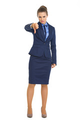 Full length portrait of business woman showing thumbs down