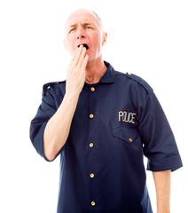 Policeman yawning