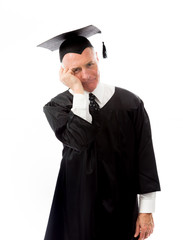 Senior male graduate thinking