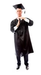 Senior male graduate making timeout gesture