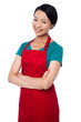 Pretty baker woman posing with arms folded