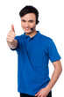 Young man with earphones and thumb up