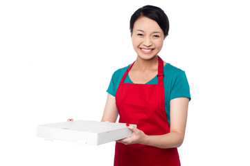 Female chef holding white pizza box