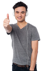 Cheerful young male listening music