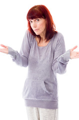 Mature woman looking confused and presenting something