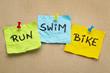 run, bike, swim - triathlon concept