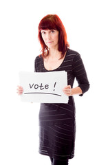 Mature woman showing vote sign on white background