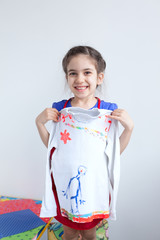 Happy girl, child with white design decorated blouse