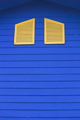Yellow window of the blue house