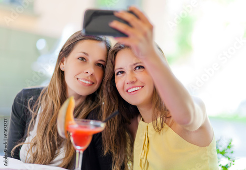 Selfie girls taking a photo of theirselves