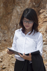 Beautiful Asian geologist woman researching.