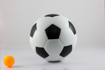 soccer ball and table tennis isolated on a white background