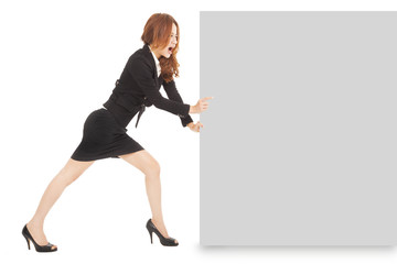 Young businesswoman pushing a blank board on white background