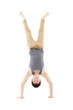 young man doing a handstand against on white background