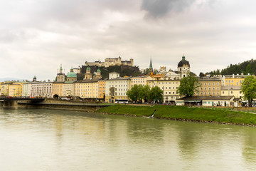 Salzburg cityscape with Salzach river in a cloudy day