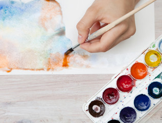 brush in the hands of the artist, watercolor painting, creativit