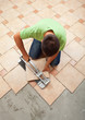 Worker cutting ceramic floor tile