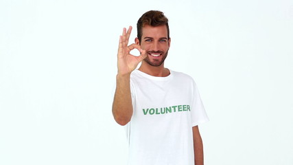 Handsome volunteer giving ok sign to the camera