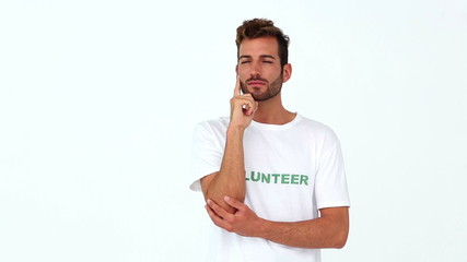Handsome volunteer thinking