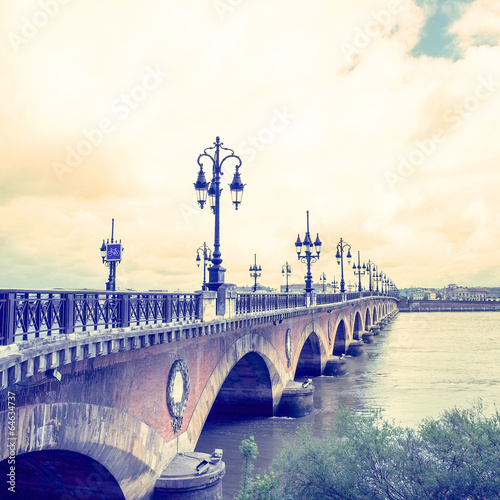 Old stony bridge in Bordeaux - 64634737