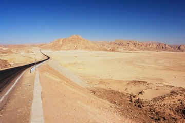 Empty road leading through the Sinai desert, Egypt