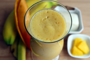 Yellow smoothie made with mango, bananas, pineapples and tofu