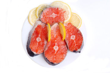 Fresh salmon steaks with lemon